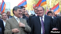 Armenia - Opposition leaders Levon Ter-Petrosian (R) and Aram Sarkisian (L) lead a demonstration in Yerevan, 28Apr2012