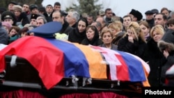 Armenia - The state funeral of the three crew members of an Armenian military helicopter shot down near Nagorno-Karabakh, Yerevan, 25Nov2014.