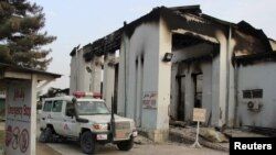FILE: A vehicle is parked in front of a damaged building at Medecins Sans Frontieres (MSF) hospital in Kunduz.
