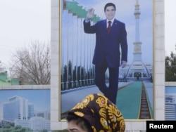 A campaign billboard displays a portrait of President Gurbanguly Berdymukhammedov in Ashgabat.