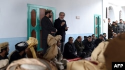 Afghan Chief Executive Officer Abdullah Abdullah (R) speaks during his official visit to the Yahya Khail district, in Paktika province on November 24.
