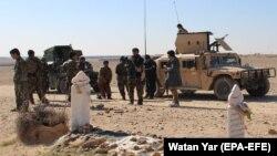 Силы безопасности Афганистана патрулируют район в провинции Гильменд. 3 марта 2020 года.