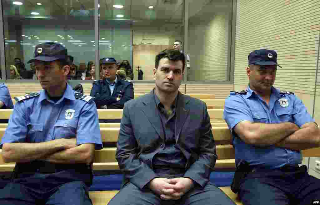 The alleged mastermind of the assassination plot, former paramilitary leader Milorad Ulemek, also known as Legija, awaits trial on May 10, 2003. He and the shooter, Zvezdan Jovanovic, were both sentenced in 2007 to 40 years in jail for conspiring to assassinate Djindjic.