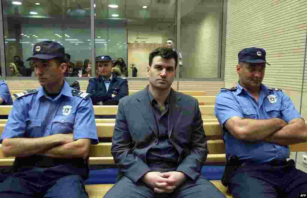 Чоловік, що стояв за вбивством Джинджича, – колишній командир напіввійськового формування Мілорад Улемек на прізвисько Легія – в очікуванні суду 10 травня 2003 року. У 2007 році його разом з Звезданом Йовановичем засудили до 40 років позбавлення волі за вбивство прем'єр-міністра