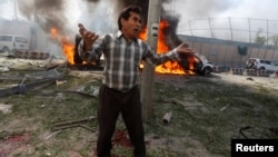 An Afghan man reacts at the site of the blast in Kabul on May 31.