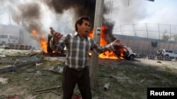 An Afghan man reacts at the site of a blast in Kabul on May 31.