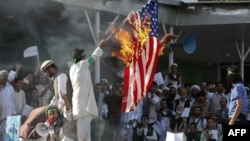 Afghan protesters set fire to a U.S. flag during a demonstration in Kabul on September 21.