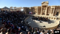 Russian conductor Valery Gergiev leads a concert in the amphitheatre of the ancient Syria city of Palmyra earlier this month, an event which was covered uncritically by a number of Western news outlets.