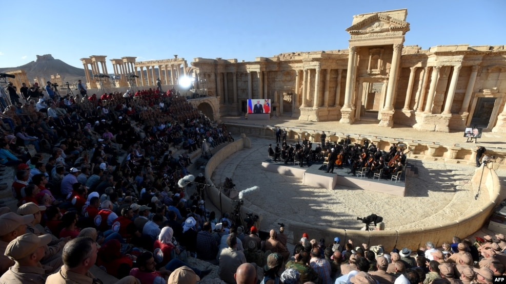 Russian conductor Valery Gergiev leads a concert in the amphitheater of the ancient city of Palmyra on May 5, 2016, after its liberation by Syrian and Russian forces.