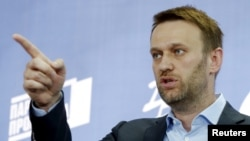 Russian opposition leader Aleksei Navalny speaks during a news conference in Moscow on April 22.