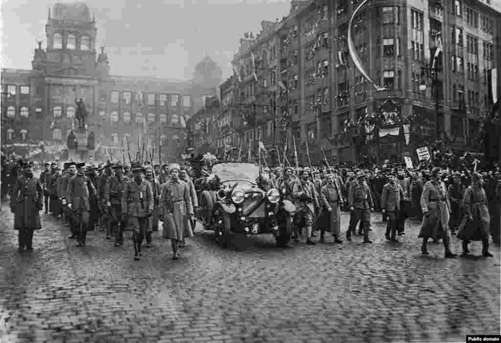 After weeks at sea, the legionnaires of Russia finally returned to their independent homeland under its new president, Tomas Garrigue Masaryk (visible inside car during his 1918 inauguration in Prague).