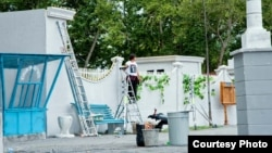 """A film crew member works on a set for """"The Way Of The Leader"""" Temirtau on August 22."""