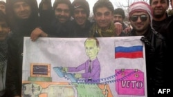 Бер төркем сүрияле Әсадка вето ярдәмендә җан өрергә тырышкан Путин карикатуры белән, Кфар Нубул