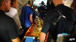 French medics carry Darline, 16, who was found alive in rubble in Port-au-Prince on January 27.