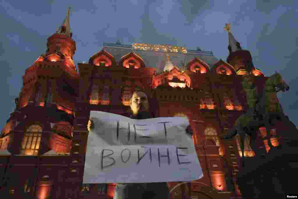 A man holds a sign during a protest against the conflict in eastern Ukraine in the center of Moscow on August 28. (Reuters/Maksim Zmeyev)
