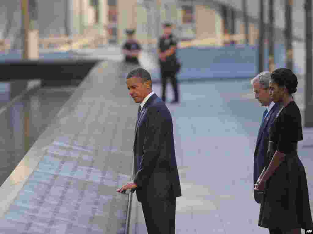 U.S. President Barack Obama, First Lady Michelle Obama, and ex-President George W. Bush visit the North Memorial Pond on the 10th anniversary of the 9/11 attacks at the National September 11 Memorial at Ground Zero in New York City.