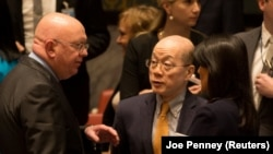 Russian ambassador to the U.N. Vasily Nebenzya (L) speaks with Chinese ambassador to the U.N. Liu Jieyi and U.S. Ambassador to the U.N. Nikki Haley at the U.N. Security Council. File photo
