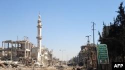 Pamje nga shkatërrimet e luftës në një lagje afër kryeqytetit Damask në Siri