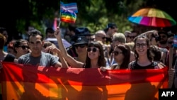 People carry rainbow-colored banners and flags during a gay-pride parade in Belgrade in June.