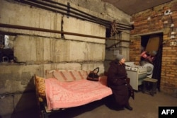 A woman waits in a shelter for shelling to end in Donetsk's Petrovski district on February 4.
