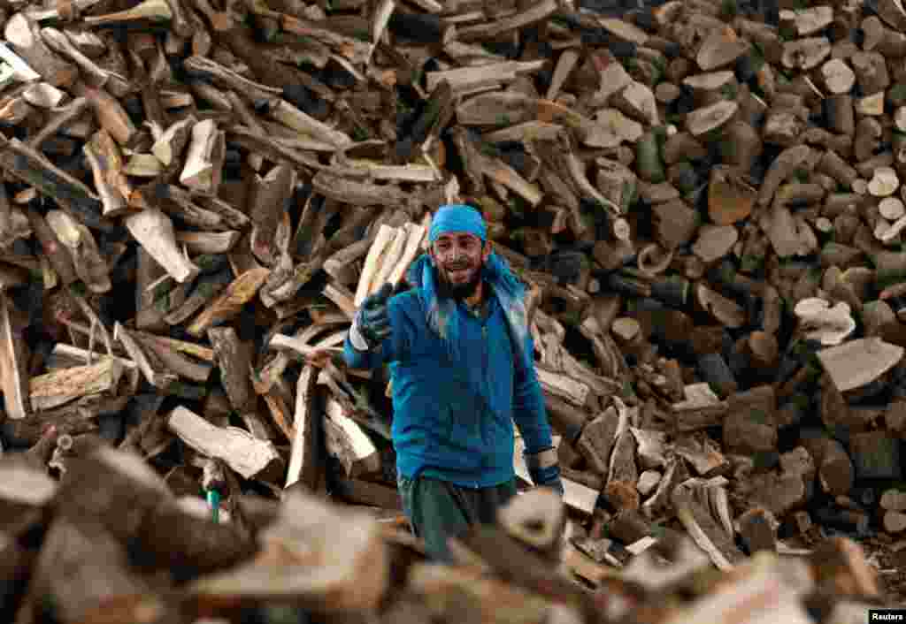 An Afghan man works at his firewood stall in Kabul. (Reuters/Mohammad Ismail)