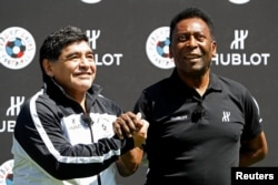 Football legends Diego Maradona (left) and Pele attend an event on the eve of the opening of the UEFA 2016 European Championship in Paris.