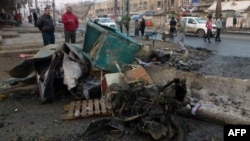 Civilians inspect the aftermath of car bomb attack that exploded in Baghdad earlier this week. Iraq has been gripped by violence in recent months.