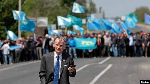 Crimean Tatar leader Mustafa Dzhemilev was met by supporters when he attempted to enter Crimea on May 3. Blocking his entry has increased tensions on the peninsula.
