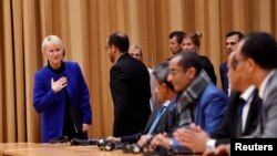 Swedish Foreign Minister Margot Wallstrom welcomes Yemeni delegates at the opening press conference on U.N.-sponsored peace talks for Yemen in Sweden.
