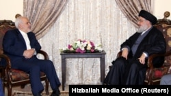 Lebanon's Hizballah leader Sayyed Hassan Nasrallah meets with Iranian Foreign Minister Mohammad Javad Zarif in this handout picture released by Hezballah Media Office, February 11, 2019. File photo