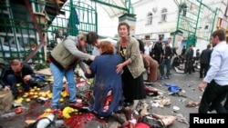 Russia -- People help the injured after a blast in Vladikavkaz, 09Sep2010