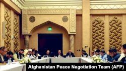 Negotiators from the government of Afghanistan get ready for a meeting with representatives of the Taliban (unseen) in Qatar's capital Doha, on September 15.