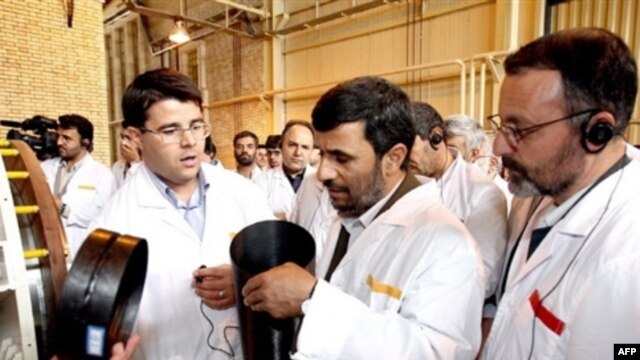 Iranian President Mahmud Ahmadinejad tours the country's Natanz uranium-enrichment facilities in April 2008.
