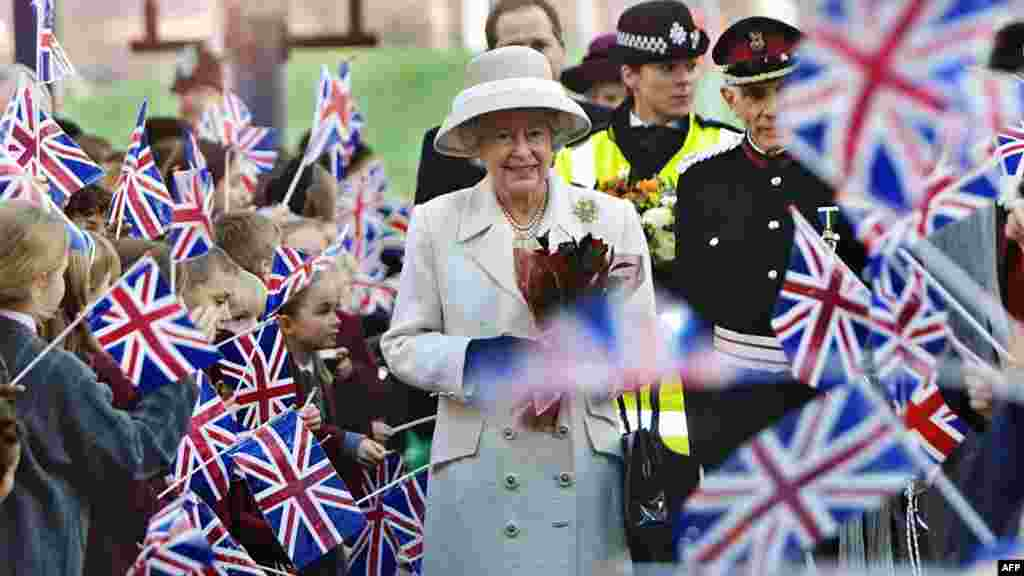 Queen Elizabeth II is greeted by well-wishers on a visit to the newly reconstructed Queen Elizabeth Hospital in London in 2001.