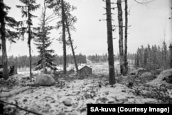 Soviet tanks (on road in background) advance into Finnish territory on December 17.