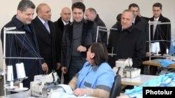 Armenia - Prime Minister Tigran Sarkisian (L) visits a textile factory in Amasia, Shirak province, 7Dec2011.