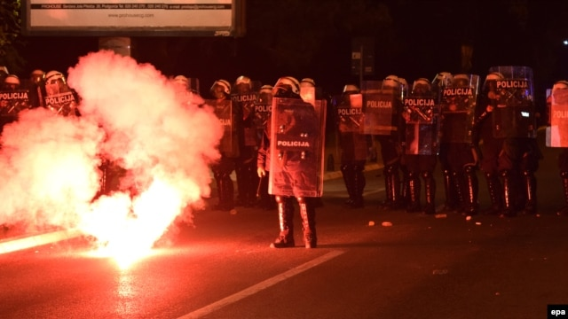 Antigovernment protesters clash with police in Podgorica on October 18. The government accuses Russia and Serbia of stirring up trouble.