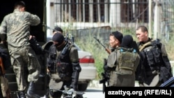 Kazakh security forces clashed with gunmen after surrounding an Almaty apartment building.