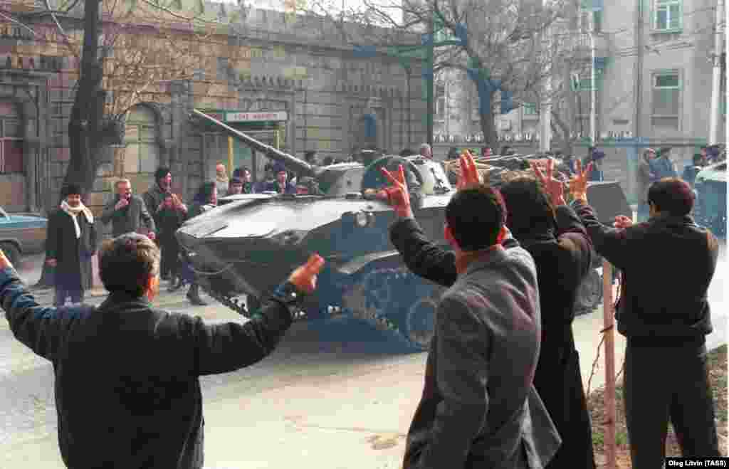 Residents of Baku wave to Soviet tanks entering their city. More than 26,000 Soviet troops invaded the capital of the Azerbaijan Soviet Socialist Republic on the night of January 19,1990.