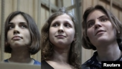 Members of the Pussy Riot punk band whose case has been sent to court (left to right): Nadezhda Tolokonnikova, Maria Alyokhina, and Yekaterina Samutsevich