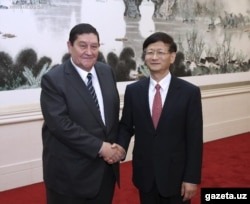 Rustam Inoyatov (left), the former head of Uzbekistan's National Security Service, during a visit to China in October 2014