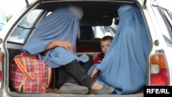 Afghan women in the back of a car in the capital, Kabul