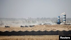 Iraqi security forces vehicles are seen in Fallujah on June 17.