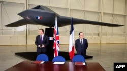 David Cameron dhe Francois Hollande