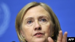 "U.S. Secretary of State Hillary Clinton says it's time for Qaddafi ""to go."""