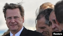 German Foreign Minister Guido Westerwelle will look to throw the EU's weight around in Belgrade.
