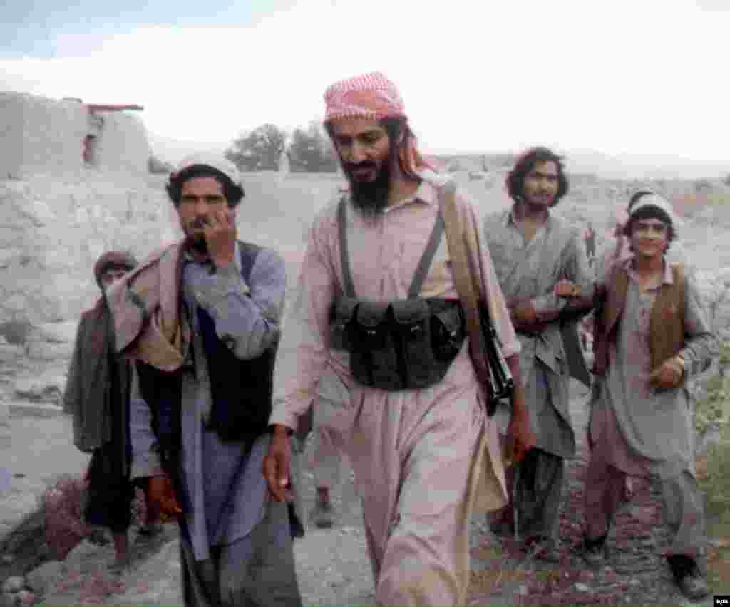 Osama bin Laden walks with Afghanis in the Jalalabad region in 1989.