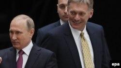 Путин и Песков, июль 2017