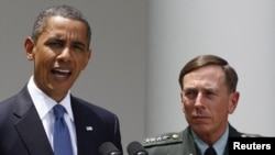 U.S. President Barack Obama with General David Petraeus , the top U.S. commander in Afghanistan