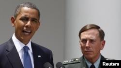 U.S. President Barack Obama with General David Petraeus , the top U.S. commander in Afghanistan